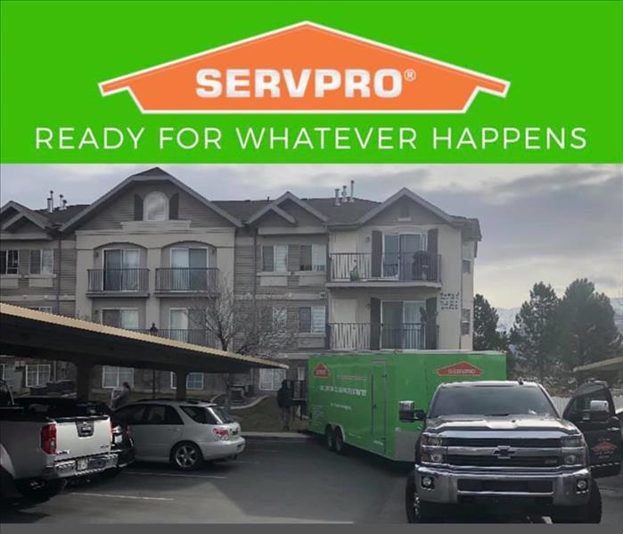 Apartment building with SERVPRO Trailer hooked to truck