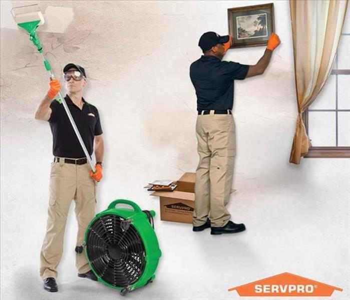 2 SERVPRO employees fixing a home