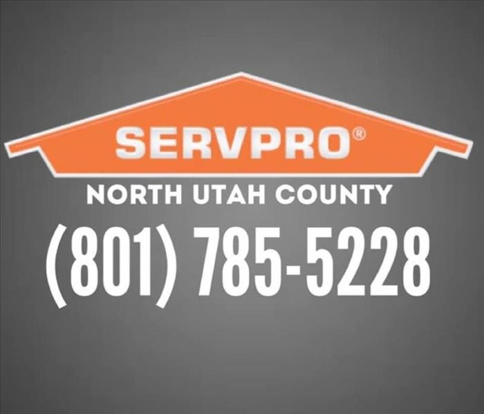 sign that say contact us today with SERVPRO logo and phone number