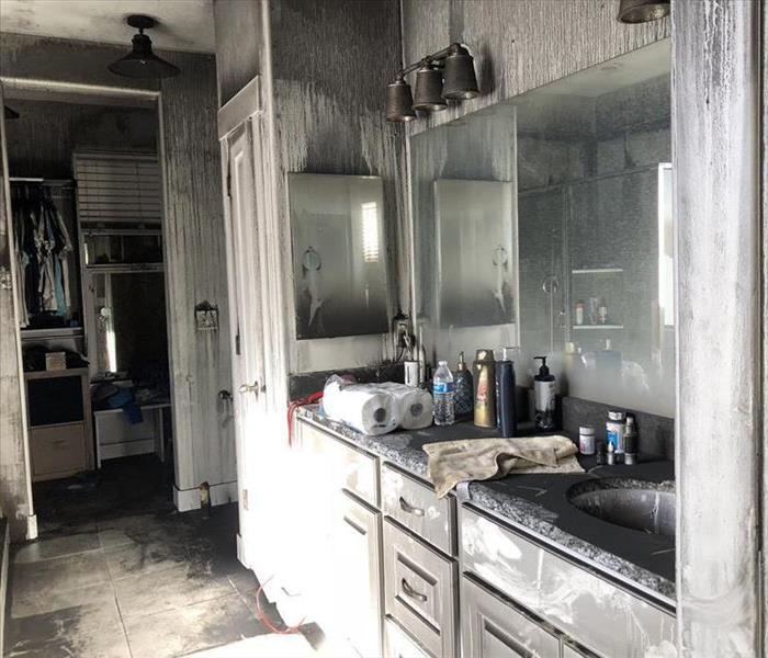 Bathroom with fire and smoke damage.